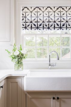 Sometimes simple is best. Add some pattern and color to your white kitchen by picking out colorful curtains.