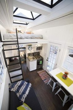 Sometimes we come across a tiny house design that simply takes our breath away with its unique detail. Sometimes we come across a tiny house design that simply takes our breath away with its unique detail. Tiny House Movement, Tiny House Plans, Tiny House On Wheels, Casa Pop, Tiny House Living, Bus Living, Living Area, Tiny House Closet, Living Room