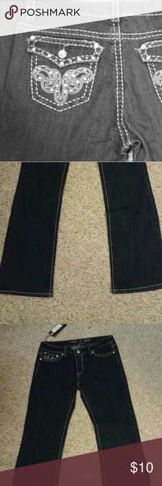 JZ Jeans Great fitting versatile blue denim jean. A little bit of bling and great stitching accent these jeans. Last pair I have. Great deal!  Marked size 11. That size is not available on the sizing chart. JZ Pants Boot Cut & Flare