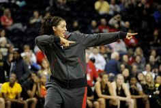 UConn center Stefanie Dolson points to her teammates as she was named to the 2014 WBCA Coaches All-America team Saturday.