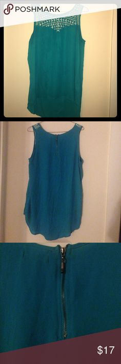 """EUC Teal and White High-Lo Sleeveless Top 🌺10% OFF BUNDLES OF 2 OR MORE!🌺 EUC pretty sleeveless top in lovely teal color with white embroidered pattern at neck and chest. Size XL. Flattering, comfy flowy fit with high-low hemline. Measurements when laid flat: 19"""" from armpit to armpit, 22"""" long in front, 29"""" long in back. Only worn 3 times. 🌈Reasonable offers welcome!🌈 Tops Tank Tops"""