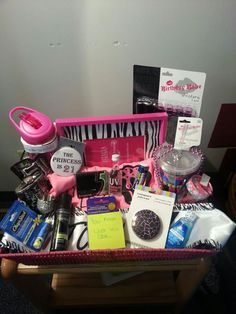 21st birthday basket: 21 gifts  -water bottle, shot glasses, mirror, chapstick, mouthwash, gum, lip gloss, flask, funnel for flask, birthday cup, birthday pin, birthday sash, picture frame, birthday beads, condoms, UV cake shot, advil, hairspray, 21st birthday shirt, birthday ring, favorite candy