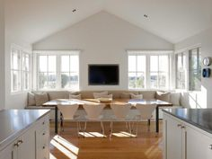 TV IN KITCHEN kitchens-light-wood-white-dining-chairs-dining-tables-light-airy-window-seats-windows