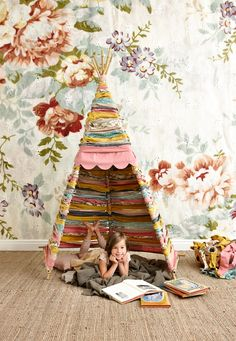 Spring Preschool Classroom Ideas: DIY Reading Tipi Tent Made with Woven Fabric Remnant Strips.