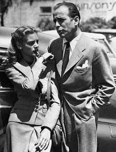 Lauren Bacall and Humphrey Bogart. Lauren had a very special charm bracelet that Humphrey gave to her...one of the charms was a whistle 40s vintage fashion style suit