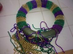 I love this!  Make a Mardi Gras wreath from last year's beads:  behindthethrills....