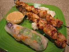 Shrimp Spring Rolls, Chicken Satay, and  Awesome Peanut Sauce. All from www.idiotskitchen.com