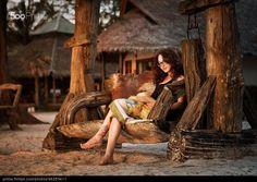 Reading at sunset by Alexey Grebennikov
