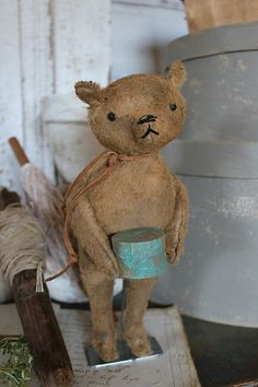 "cinnamon creek dry goods | HANDMADE | ""Posey"" Sweet ""Posey"" stands 9 1/2'' high. Holding a little wooden pantry box . He is posed on a metal stand.  52.00 plus traveling fare. SOLD"