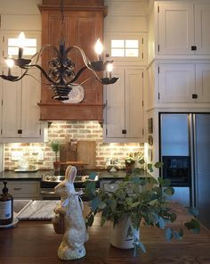 Farmhouse kitchen with stacked cabinets, brick backsplash and DIY reclaimed wood hood. We have used many reclaimed pieces.the oven hood is two vintage do Farmhouse Sink Kitchen, Kitchen Redo, Kitchen Styling, New Kitchen, Farmhouse Decor, Kitchen Ideas, Kitchen Sinks, Farmhouse Style, Warm Kitchen