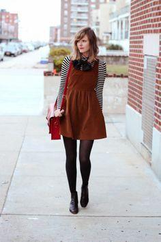 Black and white striped turtleneck, black bow, brown suede jumper, black tights, black ankle boots, and red purse.