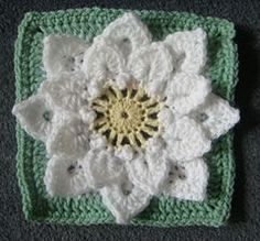 """Crocodile Stitch Afghan Block - Dahlia - by Joyce Lewis - This pattern is available as a free Ravelry download. There has been some interest lately in using the crocodile stitch in a """"flower"""" afghan block. It is usually worked in rows, not rounds, but the scales look so much like petals that using them in a flower seems an obvious step. #crochetafghans"""