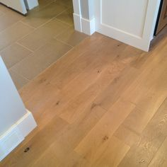 Sweet new wire brushed wood and 12x24 tiles in one of the recent homes