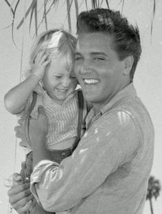 "This is Elvis with three-year-old Pam Ogles (born on December 16, 1957) on the set of ""Follow That Dream"" in Florida, July/ August 1961."