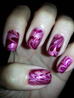 Gorgeous shimmery magenta water marble nails