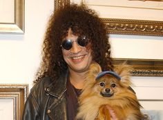 Slash and his pomeranian Foxy Brown have gone against the theory that pets look like their owners.