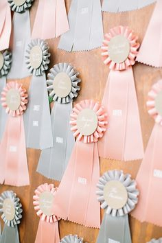 Whimsical award ribbon escort cards: http://www.stylemepretty.com/2015/01/05/springtime-greencrest-manor-wedding/ | Photography: Harrison Studio - http://www.harrison-studio.com/