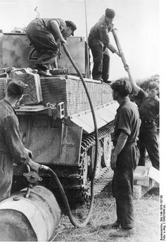 Filling up a Tiger tank. Images Of The Wehrmacht (German Army) From Tiger Ii, Nagasaki, Hiroshima, German Soldiers Ww2, German Army, Ww2 Panzer, Mg 34, Tank Armor, Military Armor