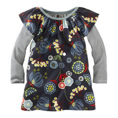 This dress leaves lots of room for stretching, playing and being a kid. Pair with your favorite leggings and she's all set! Features a print inspired by the brightest Nordic blooms.