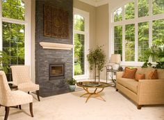 Living Room, High Ceiling, Stone Fireplace, Tall Windows