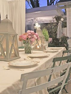 A simple but charming outdoor table  with a simple ruffled drop cloth table linen.