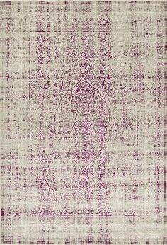 This new Jax rug from Surya features an unexpected twist on a traditional pattern with a faded magenta design (JAX-5037).