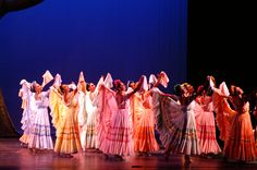 Colorful dancers perform a traditional routine on The Palace Theatre Stamford's Harman Stage