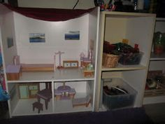 shelf becomes doll house, old ring sling for roof, pictures of awesome locations around the world flash cards as wall art in the doll house.  (My 4 yr old twin boys use their action figures, dinosaurs, and cars int he house)