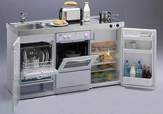 Compact all-in-one kitchen unit hides stove, fridge and dishwasher ...