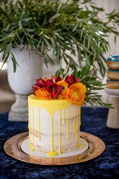 Bright Floral Drip Cake on Copper Plate.   By Laugh Love Cakes.