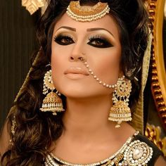MU by:Naeem Khan, Love the nose ring chain!