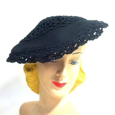 Gorgeous 1940s felted wool and crochet mesh sculpted tilt hat with grosgrain ribbon bow and veiling tied in back. Elastic band secures to back of head/beneath hair. No flaws, one size.