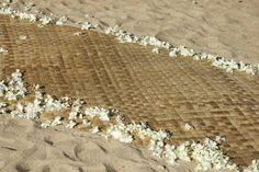 Lauhala mat with dendrobium orchid spray
