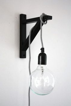 ikea shelf bracket + edison bulb + simple cord kit  source: http://poppytalk.blogspot.com/2011/08/cool-decorating-trick.html