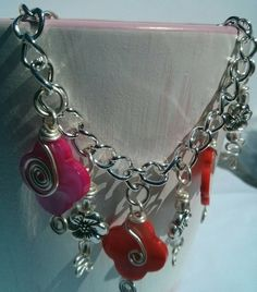 Check out this item in my Etsy shop https://www.etsy.com/listing/225227497/charm-bracelet-spring-charm-bracelet