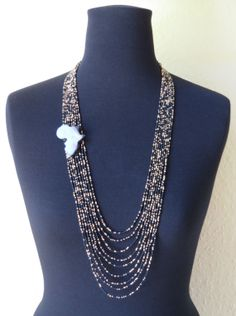 Nine strand black and metallic gold seed bead Africa adorned statement necklace.