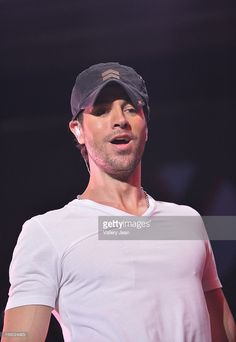 Enrique Iglesias performs onstage during Y100's Jingle Ball 2012 at the BB&T Center on December 8, 2012 in Miami.