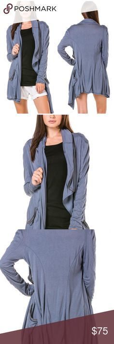 Denim blue long sleeved hoodie Soft rayon- spandex hoodie with lots of detailing, top stitching, deep pockets with zip detail. Will be your favorite wardrobe staple. Runs true to size Tops Sweatshirts & Hoodies