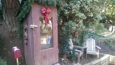 """Claudia Erickson. La Mesa, CA. This was a """"pretend outhouse"""" (never used:). Mike Campbell helped us re-purpose it into a Little Free Library. We have dedicated this to my husband Randy's 105 year old (a month away from 106!) Grandmother Leila McDougal. She was a teacher at 16 yrs of age in a 1 room school house in Kansas and has inspired so many to have a love for reading over the years!"""