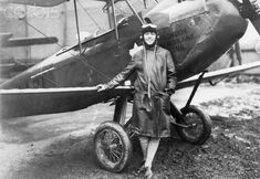 Pilot Amy Johnson Standing Beside Her Biplane
