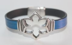 Rich Blue Leather bracelet with flower cut out by OllieBooJewelry, $40.00