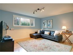 rec room with wainscoting