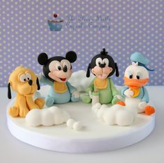 These Disney Babies Cake Topper made by The Clever Little Cupcake Company feature Pluto, Mickey Mouse, Goofy & Donald Duck Bolo Mickey, Mickey Cakes, Mickey Mouse Cake, Disney Cake Toppers, Fondant Toppers, Baby Cupcake, Lion King Cakes, Baby Cake Topper, Animal Cupcakes