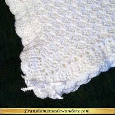 """HANDMADE BABY BLANKET WITH SCALLOPED EDGING    $45.00    These entirely handmade 39""""x39"""" blankets are hand crocheted using the softest yarn available.   This item is made to order. This means that you will not receive the item pictured but one which is made to order in the colors you request. Due to the nature of handmade items, slight variations may occur.  It will be made and shipped as soon as possible but may take 3-4 weeks before it is shipped.   Order at www.franshomemadewonders.com"""