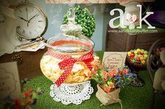 http://aandklollybuffet.com/2013/11/03/mad-hatter-tea-party-baby-shower-lolly-buffet/