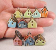 Hand formed tiny stoneware house charms/pendants - pairless leftovers from jewelry projects. Textured roofs, stamped windows and doors. Ceramic Jewelry, Ceramic Beads, Ceramic Clay, Clay Beads, Clay Jewelry, Ceramic Pottery, Clay Houses, Ceramic Houses, Art Houses