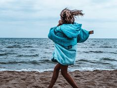 Happiness can also come in a Poncho!  Our PONCHINI MINI makes kids happy, warm and dry :)  Shop our PONCHOS @surflifebalance.  We have different designs for the entire family. #ponchinofamily #livetheponcholife #iliveinmyponcho