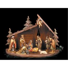 """From Bavaria, Germany comes this wonderful example of old world craftsmanship, a  Scully & Scully exclusive. Carved in solid maple wood, then handpainted and gilt, are the traditional figures of the Nativity: Mary, Joseph, Baby Jesus, the  three kings, two shepherds, a lamb and an angel proclaiming the birth of Christ to hang at the top. Standing figures are approximately 6""""h.   The creche measures 19 ¼"""" x 9 ½ x 14 ¼""""h"""