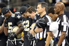 a36e0dfaa Drew Brees joins his fellow Saints and the officials during a moment of  silence for the