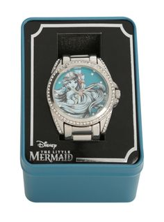 Silver tone watch with a sketch of Ariel and clear gem trim in a collectible tin!